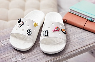 The Classic Crocs Slide in White, with Jibbitz™.