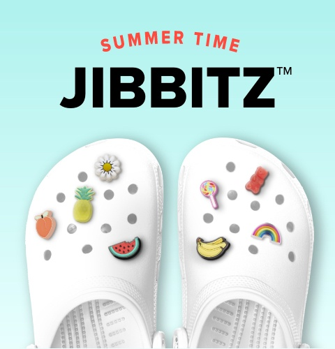 Crocs Classic Clog in White with Assorted Summer Jibbitz.