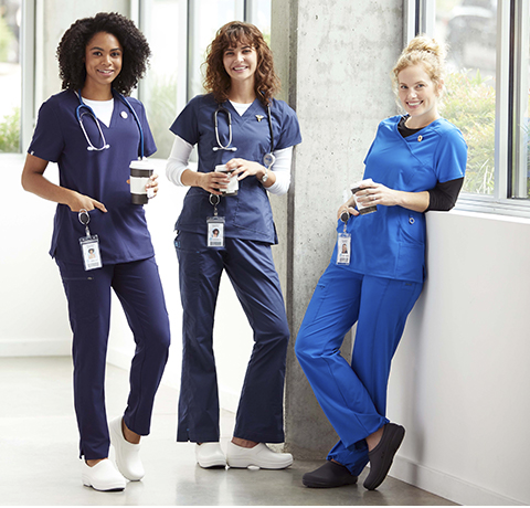Three nurses wearing Crocs at Work styles.