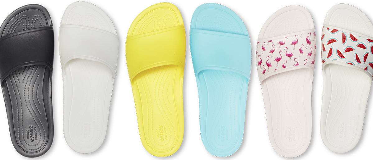 Women's Crocs Sloane Slides in Black, White, Lemon & Pool Blue; & Women's Crocs Sloane Seasonal Graphic Slide in Flamingo/Barely Pink & Watermelon/White.