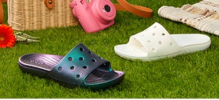 Classic Crocs Iridescent Slides in White and Black.
