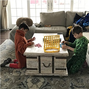 Kid in Crocs playing board games.