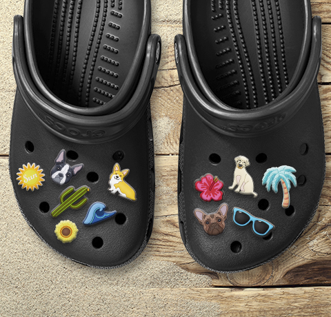 Classic Clog in Black with a variety of Jibbitz.