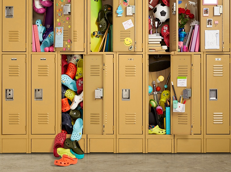 School lockers filled with school supplies and Crocs Classic Clogs with Jibbitz.