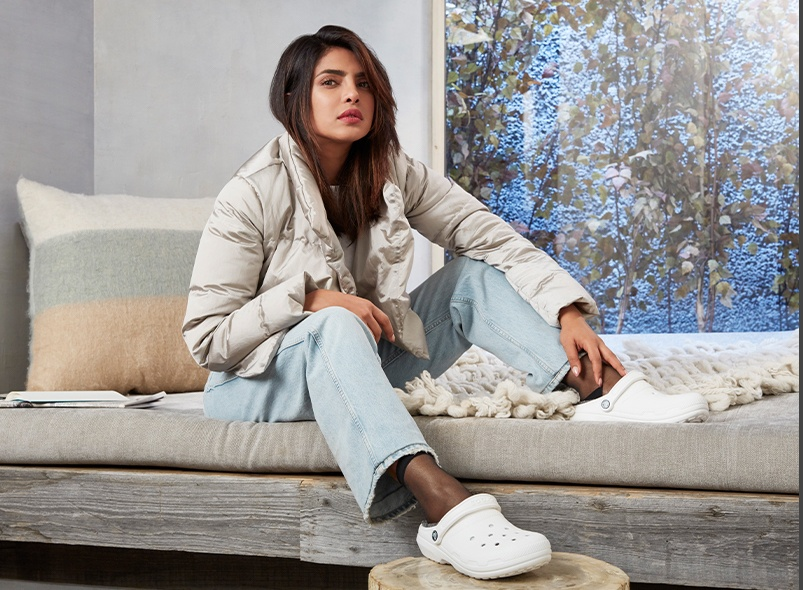 Priyanka Chopra Jonas wearing Classic Lined Clogs in White/Grey.