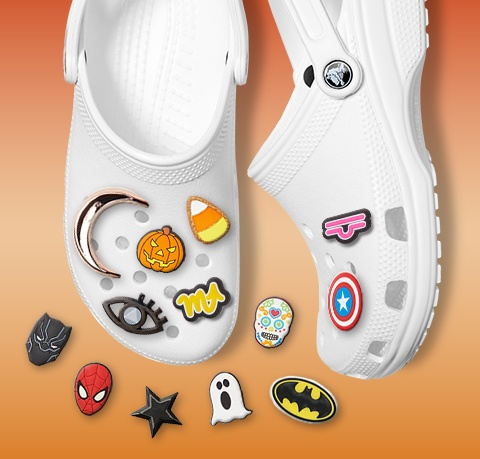 Classic Clogs in white with Marvel, DC Comics, and Halloween Jibbitz.