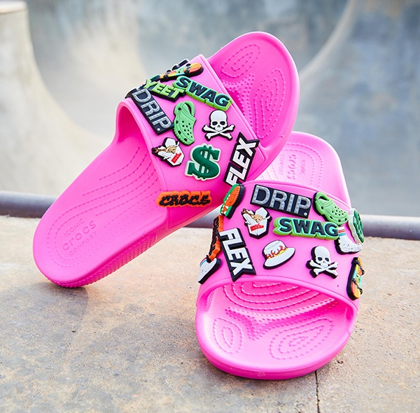 Classic Crocs Slide in Electric Pink.