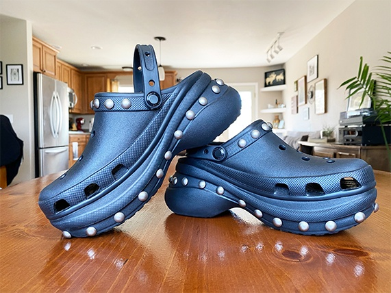 Navy Bae clog with white studs.