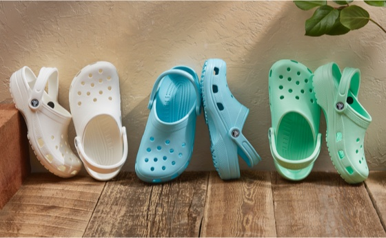 Crocs Classic Clogs in a row.