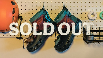 Sold Out, Nicole McLaughlin X Crocs with compass, headlamp, pocket and rope.