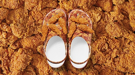 Kentucky Fried Chicken® Classic Clogs featuring drumstick Jibbitz™ on top.