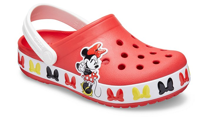 Real Fun Shoes For Real Fun Kids  Disney's Minnie Mouse has been charming fans of all ages for more than 90 years, and this new clog is the perfect day-to-day summer hit for the little Disney fan in your life. Crocs Fun Lab styles feature original character-rich graphics and other inspired designs to help kids express themselves and engage new friends, resulting in more fun for the little ones.  Kids\\\' Crocs Fun Lab Disney Minnie Mouse Band Clog Details:    Bands and uppers featuring Minnie Mouse graphics where kids can interact with them  Pivoting heel straps for a more secure fit  Croslite™ foam outsoles for better traction, support and comfort  Customizable with Jibbitz™ charms  Iconic Crocs Comfort™: Lightweight. Flexible. 360-degree comfort.    © Disney