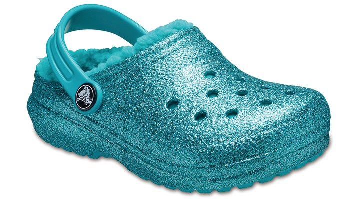 The Snuggle Is RealA cozy lining inside and a whole lot of sparkling glitter outside make this clog a year-round hit for kids who love stepping into the spotlight. Fuzz lining adds a layer of comfort and snuggle kids will love to wear as an indoor slipper or outdoors, even on cold-weather days. Crocs Classic Clogs feature lightweight Iconic Crocs Comfort™ and a color for every personality, and remind kids of all ages to go out and play.  Kids' Classic Glitter Lined Clog Details:    Pivoting heel straps that let them choose between clog and slide styles  Croslite™ foam construction for comfort and cushion  Customizable with Jibbitz™ charms  Dual Crocs Comfort™: Blissfully supportive. Soft. Cradling comfort.